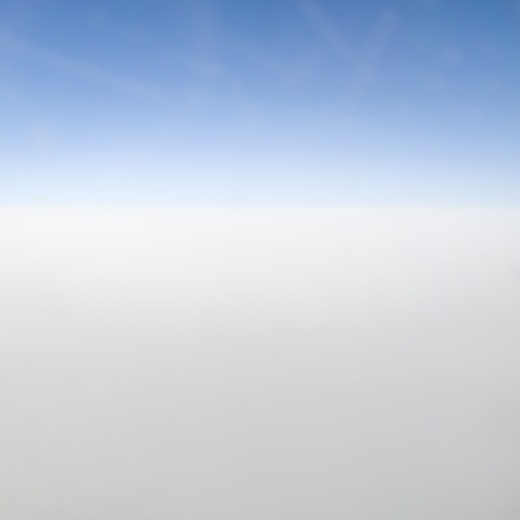 Blue sky over clouds at 10,000 feet